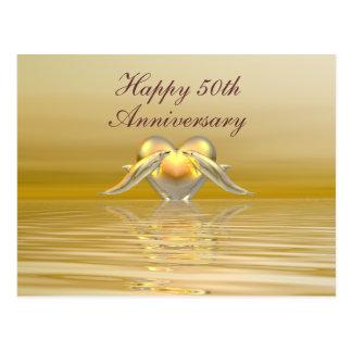 Delfínes y corazón de oro del aniversario tarjetas postales