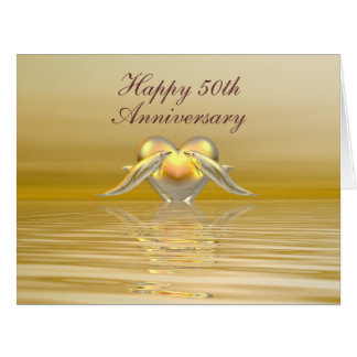 Delfínes y corazón de oro del aniversario tarjetón