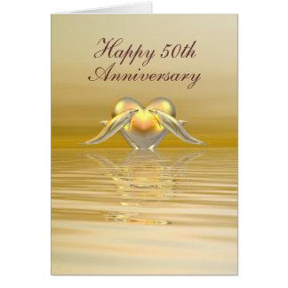 Delfínes y corazón de oro del aniversario felicitación