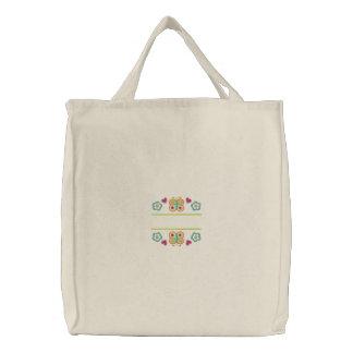 Descenso conocido de la mariposa y de la floración bolsa de tela bordada