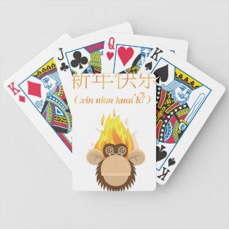 Deseo feliz del Año Nuevo de la cabeza del mono de Barajas De Cartas
