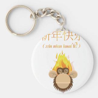 Deseo feliz del Año Nuevo de la cabeza del mono de Llavero Redondo Tipo Chapa