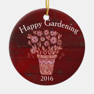 Deseo feliz del navidad que cultiva un huerto adorno de cerámica