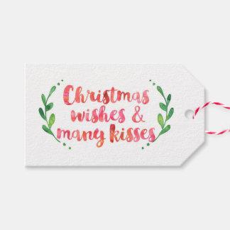 Deseos del navidad y muchas etiquetas del regalo