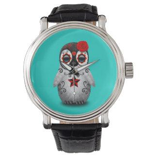 Día rojo del pingüino muerto del bebé reloj