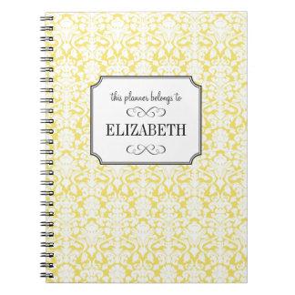 Diario blanco amarillo de oro del planificador del libros de apuntes con espiral