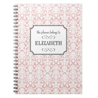 Diario blanco rosado polvoriento del planificador  libreta espiral