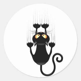 Dibujo animado divertido del gato negro que pegatina redonda