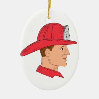 Dibujo del casco del vintage del bombero del adorno navideño ovalado de cerámica