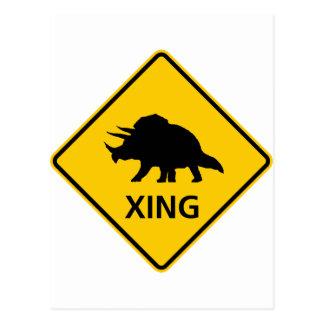 Dinosaurio de la muestra de la carretera de la postal