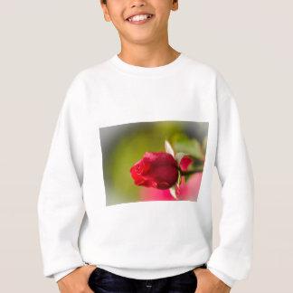 Diseño ascendente del cierre del rosa rojo sudadera