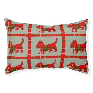 Diseño del perrito del tartán en cama interior del