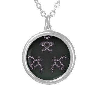 Diseño oscuro del fondo del fractal infinito de colgante redondo