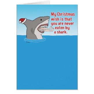 Divertido comido por navidad del tiburón tarjeta de felicitación