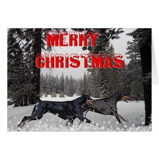 Dobermans del navidad de la nieve tarjeta de felicitación