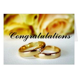 Dos anillos de bodas del oro tarjeta de felicitación
