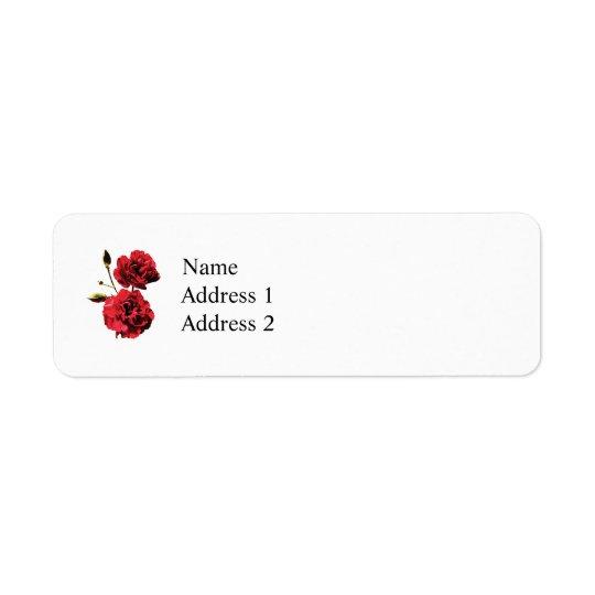 Dos claveles rojos con los brotes etiqueta de remitente