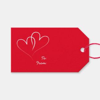 Dos corazones rojos etiquetas para regalos