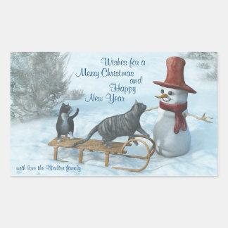 Dos gatos y un muñeco de nieve pegatina rectangular