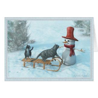 Dos gatos y una tarjeta de felicitación del muñeco