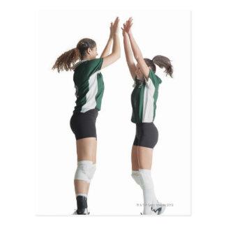 dos jugadores de voleibol femeninos caucásicos del postal