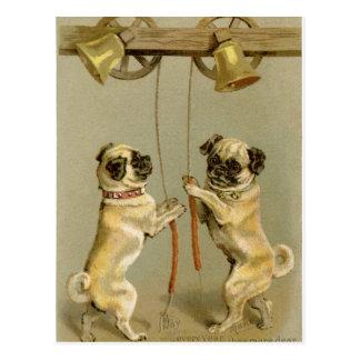 Dos perros del barro amasado que suenan las postal