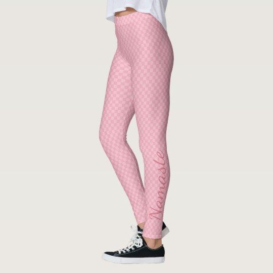 Dos sutiles entonaron el tablero de damas rosado leggings
