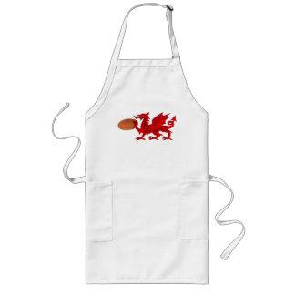 Dragón Galés con un delantal de la cocina de la