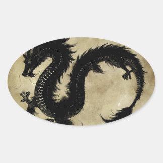 Dragón negro pegatina óval