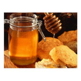 Dulces de la comida de la miel pegajosos postal