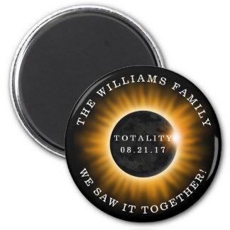 Eclipse solar de la totalidad de la familia imán