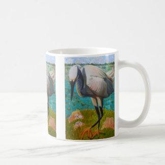 Egret listo para pegar la taza