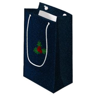 El acebo del invierno sale del bolso nupcial del bolsa de regalo pequeña