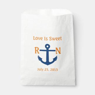 El amor es naranja náutico dulce de la marina de bolsa de papel