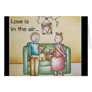 El amor está en la tarjeta romántica divertida del