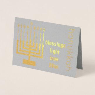 El año de encargo del oro del día de fiesta de tarjeta con relieve metalizado