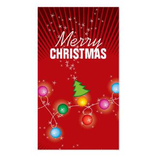 El árbol de navidad chispeante colorido enciende tarjetas de visita