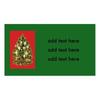 El árbol de navidad iluminado por velas adorna la tarjetas de visita