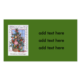El árbol de navidad iluminado por velas presenta tarjetas de visita