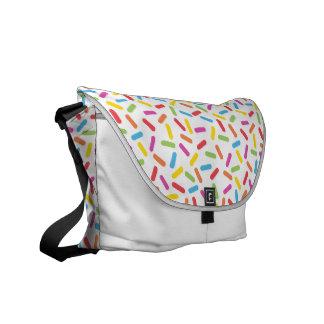 El arco iris asperja bolsa de mensajeria