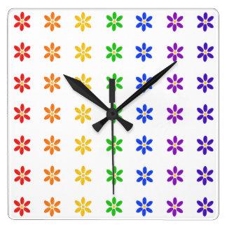 El arco iris florece el reloj moderno