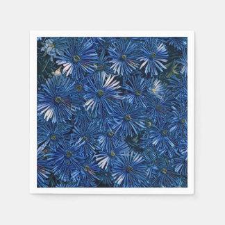 El azul estilizado florece la servilleta de papel