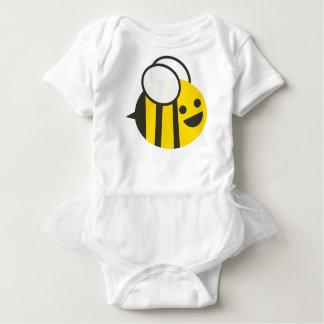 El bebé inepto manosea el tutú de la abeja body para bebé