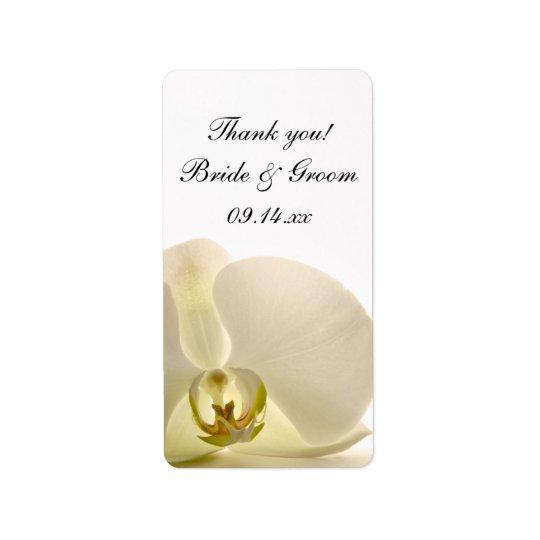El boda blanco de la flor de la orquídea le etiqueta de dirección