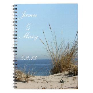 El boda del tema de la playa planea el cuaderno