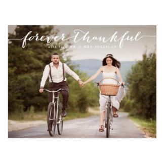 El boda el   blanco agradecido de la escritura le postal