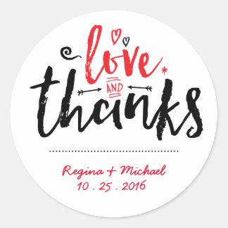 El boda rojo negro de la tipografía le agradece pegatina redonda