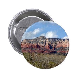 el botón redondo con la foto del rojo de Arizona