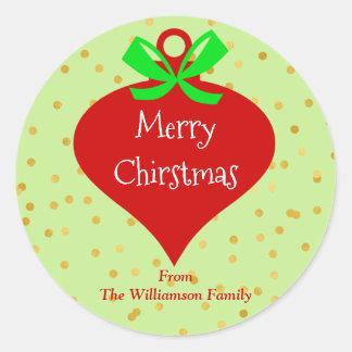 El bulbo de las Felices Navidad puntea la etiqueta