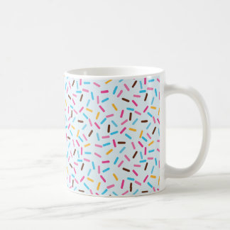 El buñuelo asperja la taza